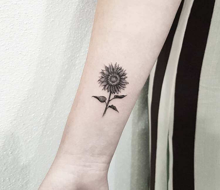 Black and Grey color sunflower tattoo on ARM