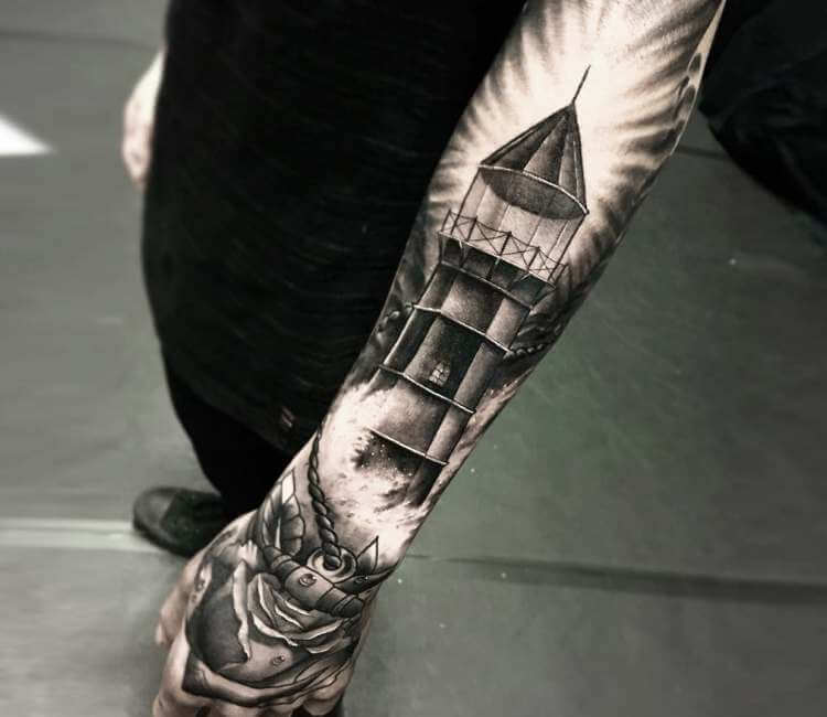 b52d1e98a black and gray lighthouse tattoo by martin rothe