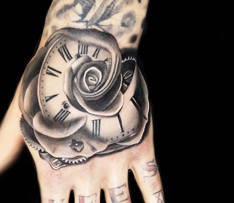 rose tattoo hand